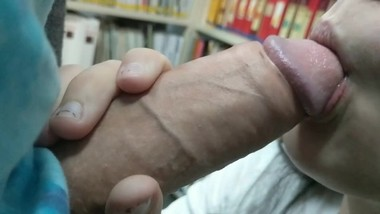Nerdy girl masturbates and sucks a big cock in a library (no panties)