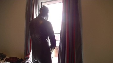 Teen Latex Catsuit Wank Out of a Hotel Window in Broad Daylight! Cum