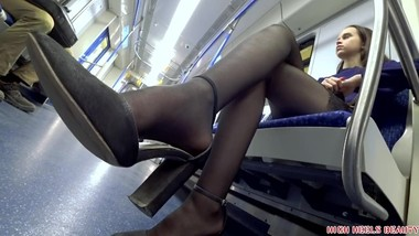 Brunette Student in black stockings and high heel