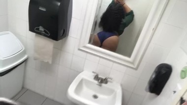 Hispanic teen shows off her ass in public bathroom