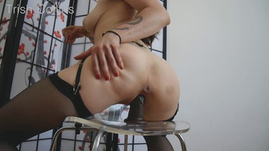 She rides a dildo on her chair until she cums hard.