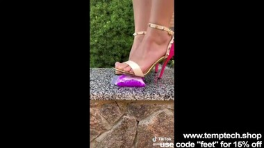 Crushing bags of water with my pink heels - Foot Fetish