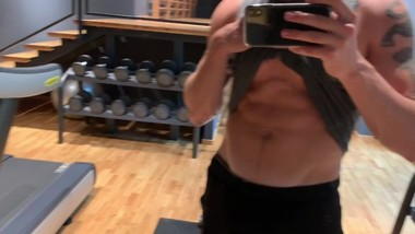 Watch me show off my body in the gym and cum a big load in the hotel shower