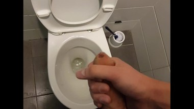 Wanking in public toilet